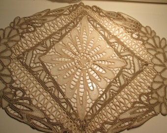 Old and beautiful beige and gold lace doily.