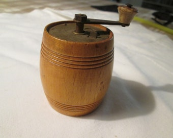 Former wooden pepper mill in the form of small barrel, 6cm high.
