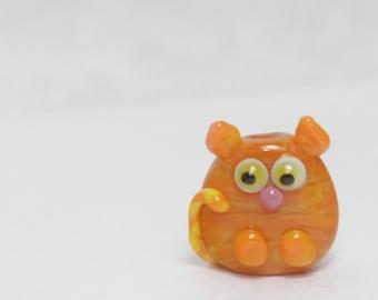Glass Cat Lampwork Focal Bead. Orange with yellow dots