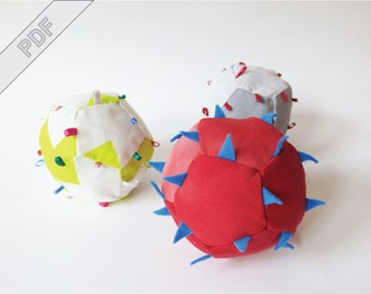 Sewing tutorial with pattern for a soft baby toy, rattle grab ball, be-ribboned plushie, dodecahedron with noise maker