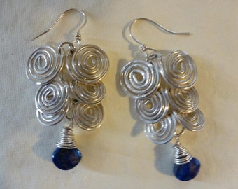 16 gauge Argentium silver wire, shaped and hammered in The Egyptian Coil design; three graduated tiers ending in lushly wrapped  Lapis brios