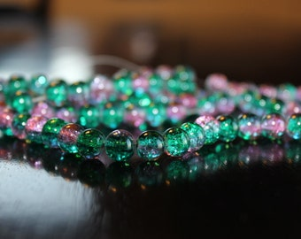 100 approx. teal or green and hot pink, 8 mm crackle glass beads