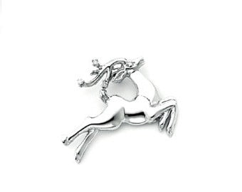 Sterling Silver Reindeer pendant with diamonds.