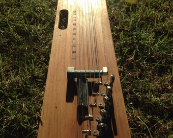 Lap slide plank guitar with handle