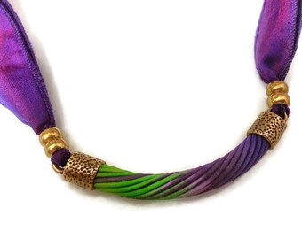 Sari silk and polymer clay necklace. Purple and green