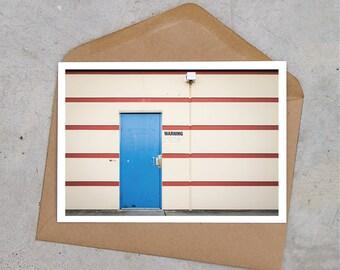 blue door + red stripes urban industrial postcard