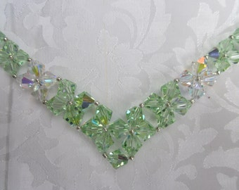 Swarovski Chrysolite V shaped necklace and earrings dazzle with pale green crystal elegance
