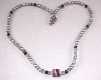 Garnet, pearl,  and fluorite necklace with lampwork focal bead