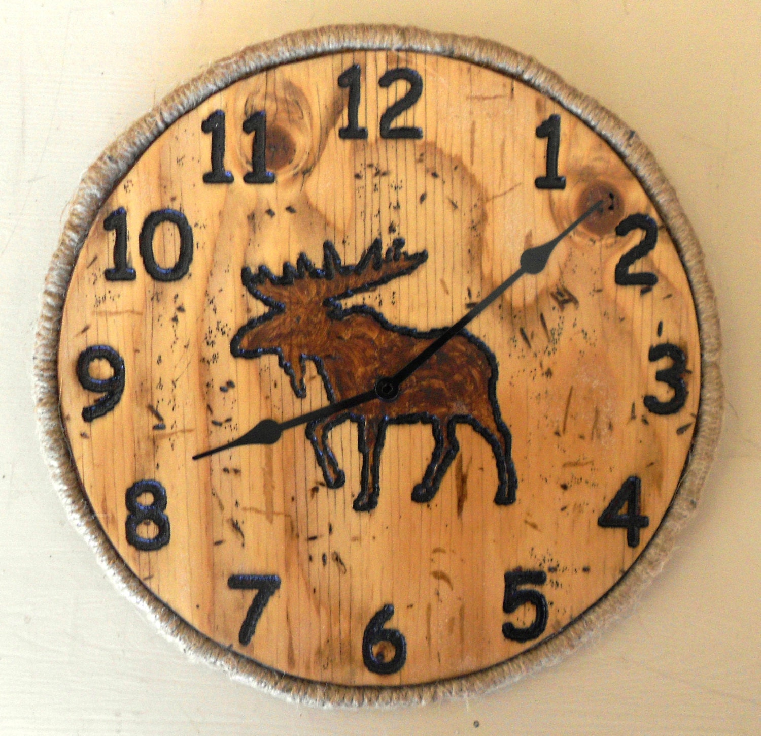 Round moose clock carved from pine with rope border log
