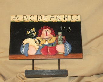 Raggedy Ann teacher with apples, lamb, school books and flowers