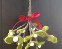 Mistletoe.Wonderful felt mistletoe sprig tied with red ribbon.