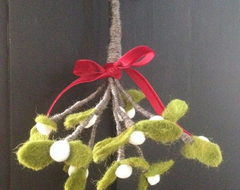 Mistletoe.Wonderful felt mistletoe sprig tied with red ribbon.