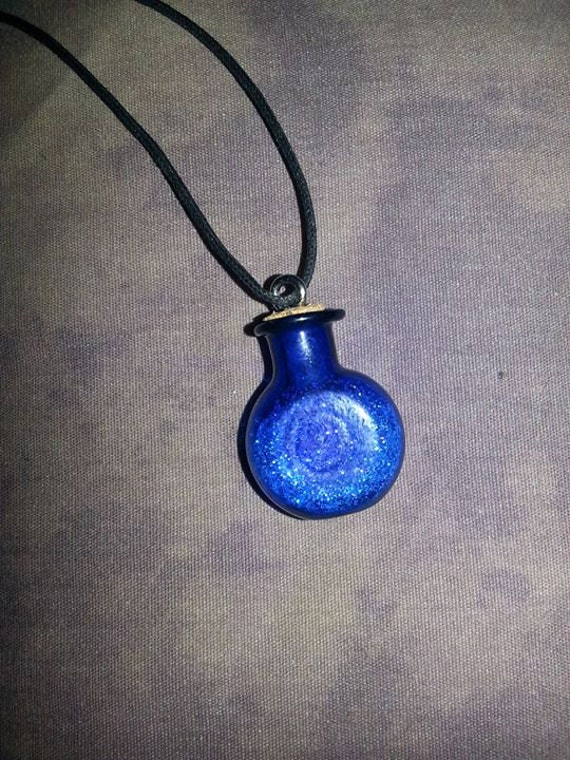 blue glass pixie dust necklace by crinolinegremlin