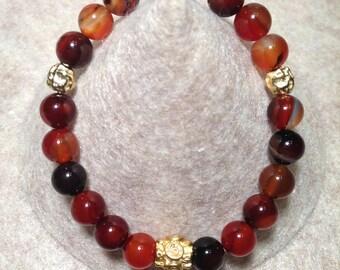 Genuine Carnelian stretch bracelet with gold plated details