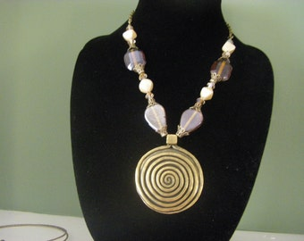 Statement Necklace in darker Earth tones.....good for blending with most outfits but still stand out in a crowd !