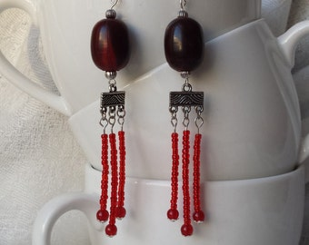 Red chandelier earrings, tribal bead look