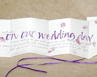 on our wedding day, purple text, from bride to groom, from groom to bride, handwritten card, pink petal paper, love letter,