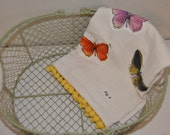 Hand made butterfly applique towel with yellow pom pom trim.