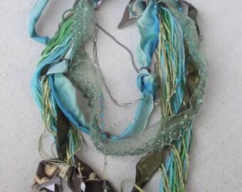 Fiber and chain aqua marine necklace