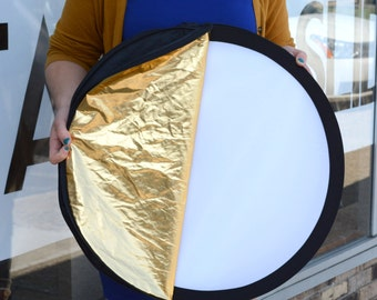 5-in-1 Reflect-A-Disc Collapsible Reflector: gray card, white diffuser, white bounce, black reflector, gold reflector, and silver reflector!