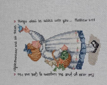Counted cross stitch Bible verse with girl and bird. Seek ye first the Kingdom of God...