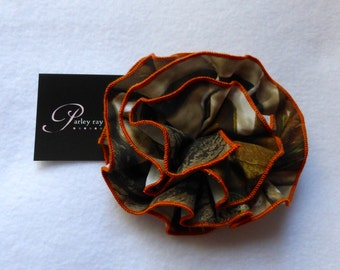 Orange REALTREE Camo Fabric Hair Bow on a Double Prong Alligator Clip