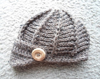 Textured  Newsboy Hat. Available in Sizes: Newborn, 0-3 Mths, or 3-6 Mths.