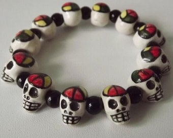 Skull Rasta Ceramic Stretch Bracelet. Skull ceramic Beads and Onyx Spacers. Handmade in Peru