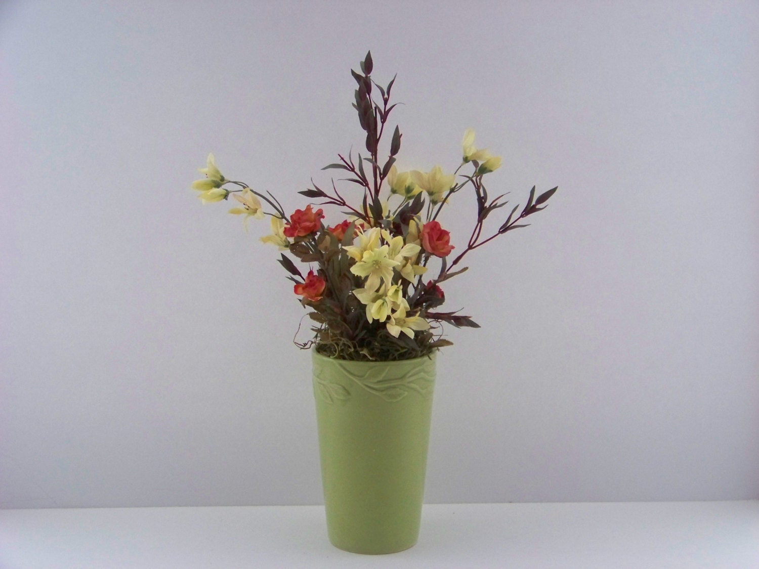 Artificial silk flower arrangement centerpiece use for spring