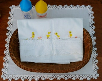 SHEET former embroidered crib