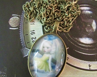 Dreamy Girl Pendant in Brass Setting Under Polished Glass