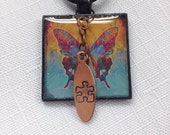 Autism necklace - autism jewelry free shipping butterfly image in hand poured resin with hand stamped puzzle piece. By Geneva's Sky