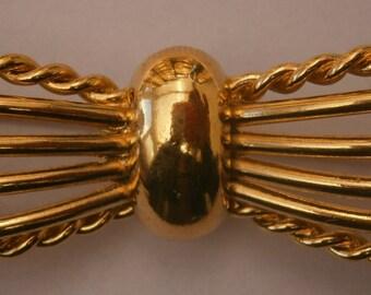 A162) A stylish vintage gold tone modernist style bow brooch