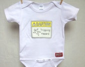 Baby Onesie. Caution: Tripping Hazard