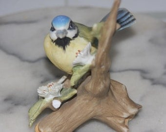 Vintage Bird Figurine .