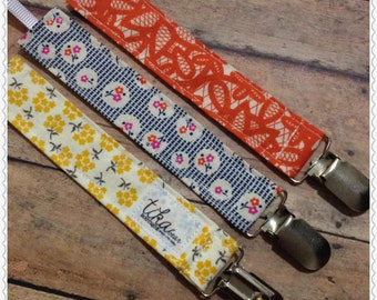 Set of three universal pacifier clips