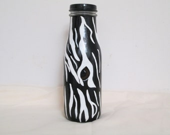 Hand painted Zebra design on a glass bottle.