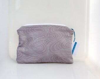 makeup bag, lined pouch, lined makeup pouch, plastic lined bag, zippered bag, zippered pouch, zippered makeup bag