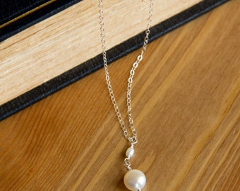 Button Pearl Wire Wrapped on a Sterling Silver Chain with a teeny, tiny pearl.