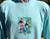 vintage 80s sweatshirt raglan PARROT tropical birds crewneck sweater Medium teal cross stitch