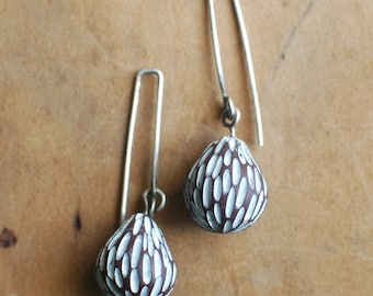 Husk drop earrings