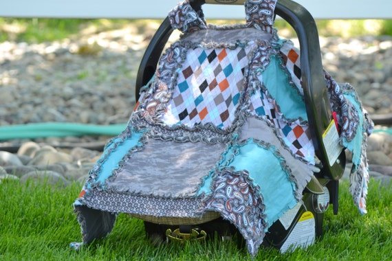 turquoise and gray argyle car seat tent