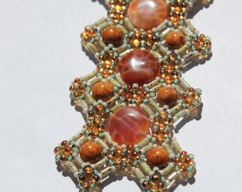 Hand Beaded cuff style Bracelet with brown river stone, Orange dragon vein coin agate and seed beads