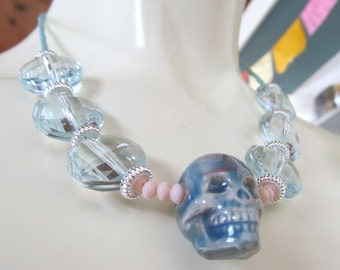 beaded RAKU SKULL NECKLACE -- soft baby blue, slate blue, blush pink (17 1/2 inch; shorter length)