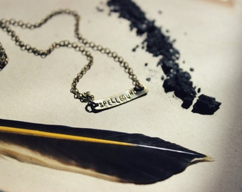 Incarnation. Hand-stamped Antiqued Brass Bar and Quartz Crystal Necklace.