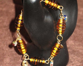 Amber colored Lamp Worked Glass Bead Bracelet with Cloisonne Beads on Red Brass