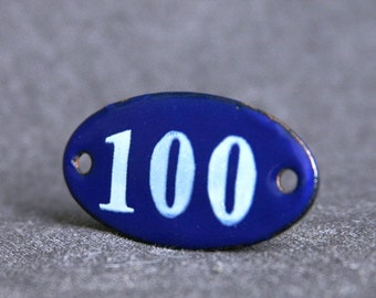Got 100. Vintage blue enamel numbered plate.