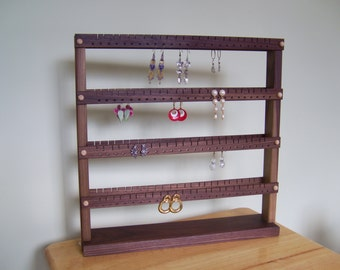 Double sided black walnut earring holder, holds up to 192 pairs of earrings.