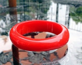 Chunky Asymmetrical Lucite Bangle in Classic Cherry Red