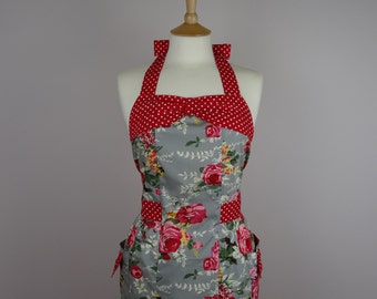 Retro apron with bow, red floral pattern on a grey background, fully lined.
